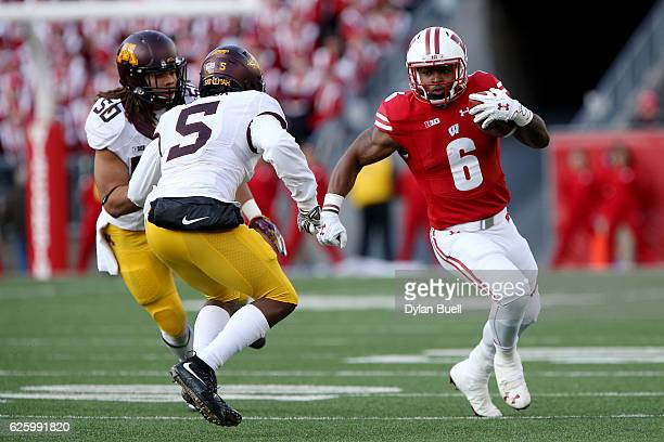 Corey Clement of the Wisconsin Badgers runs with the ball in the second quarter against the Minnesota Golden Gophers at Camp Randall Stadium on...