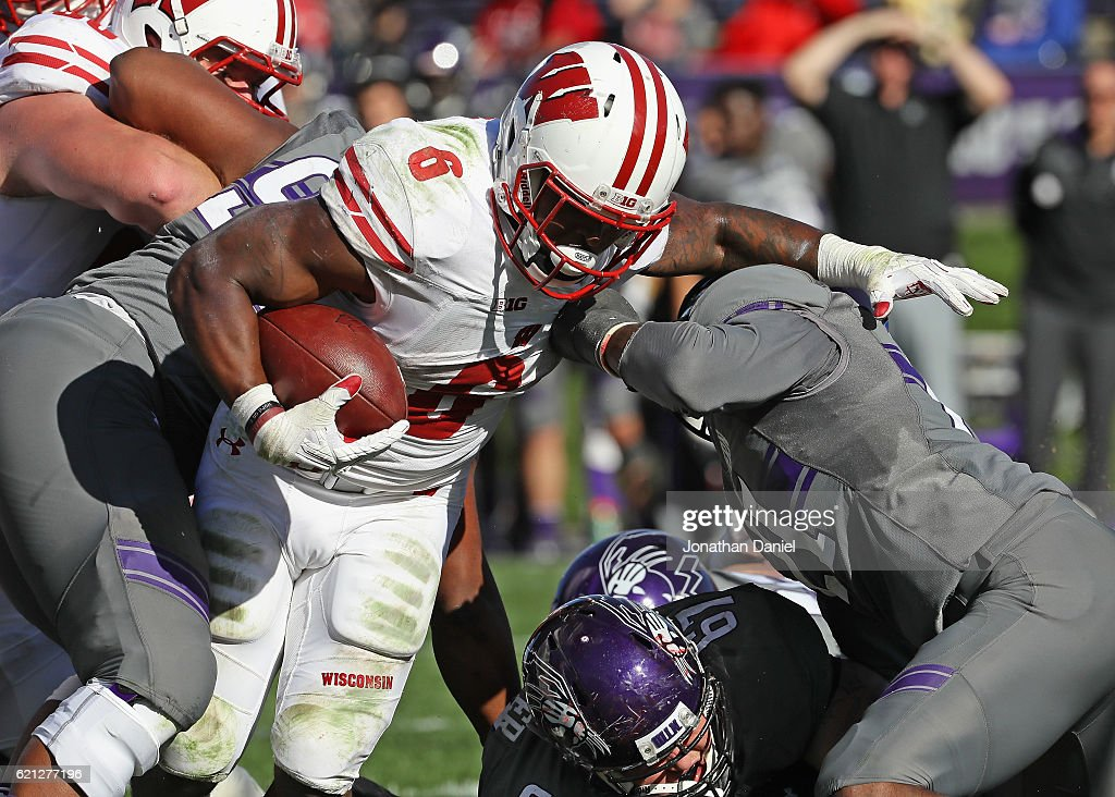 Corey Clement #6 of the Wisconsin Badgers rushes over Tyler Lancaster #67 and Kyle Queiro #21 of the Northwestern Wildcats to score a touchdown in the 4th quarter at Ryan Field on November 5, 2016 in Evanston, Illinois. Wisconsin defeated Northwestern 21-7.