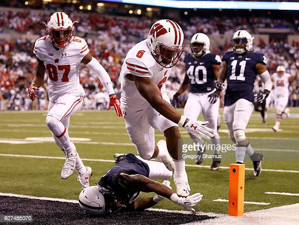 Corey Clement of the Wisconsin Badgers scores a touchdown in the first quarter of the Big Ten Championship against the Penn State Nittany Lions at...