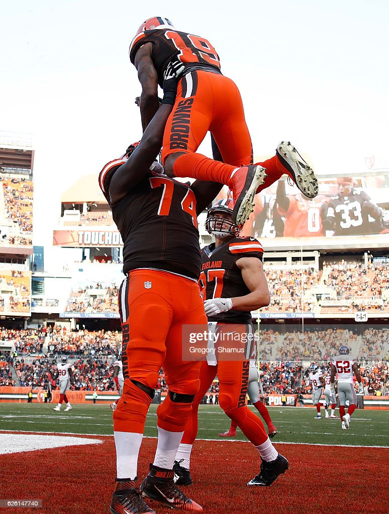 Corey Coleman #19 celebrates his touchdown with Cameron Erving #74 of the Cleveland Browns during the fourth quarter against the New York Giants at FirstEnergy Stadium on November 27, 2016 in Cleveland, Ohio.