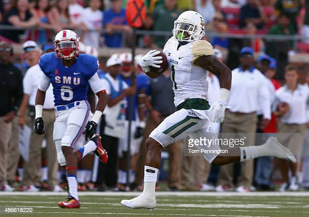 Corey Coleman of the Baylor Bears carries the ball against Jesse Montgomery of the Southern Methodist Mustangs in the first half at Gerald J. Ford...