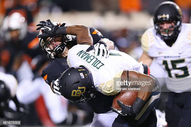 Corey Coleman of the Baylor Bears tries to break a tackle in the first quarter against the Oklahoma State Cowboys at Boone Pickens Stadium on...