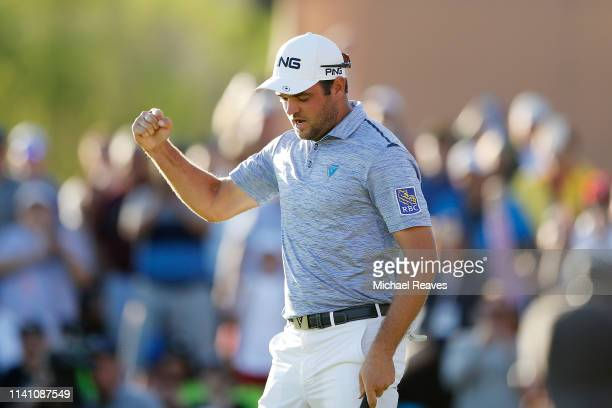 Corey Conners of Canada celebrates on the 18th green after winning the 2019 Valero Texas Open at TPC San Antonio Oaks Course on April 07 2019 in San...