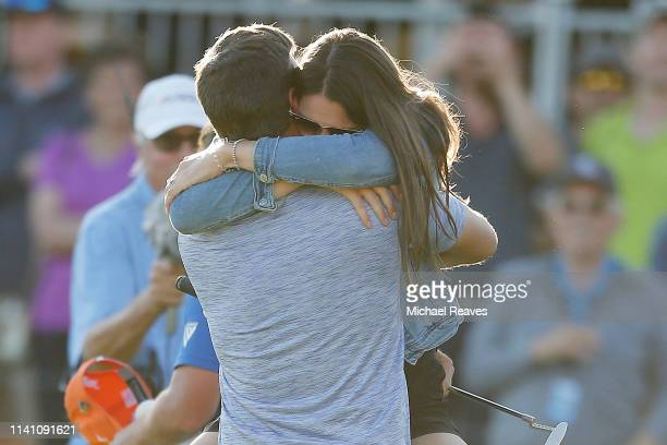 Corey Conners of Canada celebrates with his wife Malory Conners on the 18th green after winning the 2019 Valero Texas Open at TPC San Antonio Oaks...
