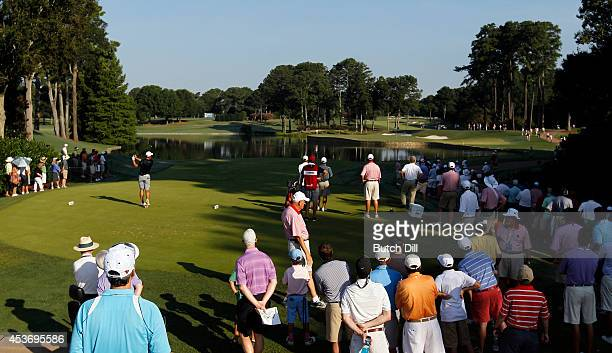 Corey Conners of Canada hits his tee shot on hole four during the semifinal match of the US Amateur Championship on August 16 2014 at the Atlanta...