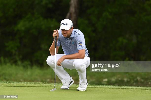 Corey Conners of Canada lines up a putt for birdie on the first green during the final round of the 2019 Valero Texas Open at TPC San Antonio Oaks...