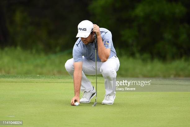 Corey Conners of Canada lines up a putt for birdie on the first hole during the final round of the 2019 Valero Texas Open at TPC San Antonio Oaks...