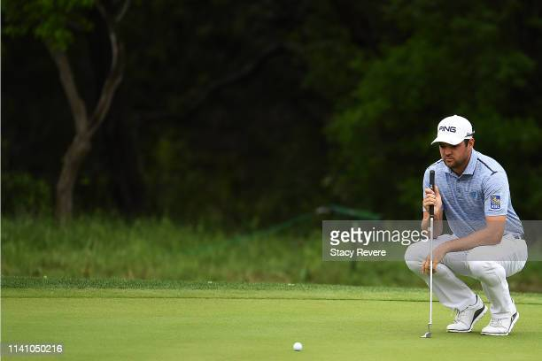 Corey Conners of Canada lines up a putt on the first green during the final round of the 2019 Valero Texas Open at TPC San Antonio Oaks Course on...
