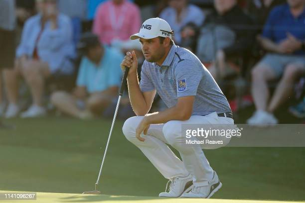 Corey Conners of Canada looks over a putt on the 18th green during the final round of the 2019 Valero Texas Open at TPC San Antonio Oaks Course on...