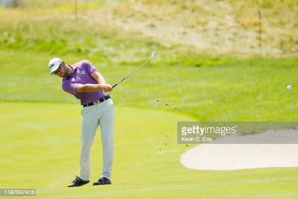 Corey Conners of Canada plays a shot on the 15th hole during the second round of The Northern Trust at Liberty National Golf Club on August 09 2019...