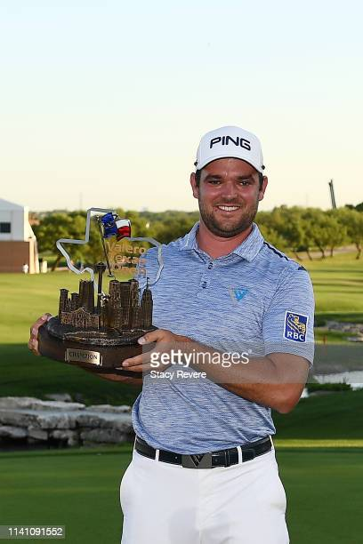 Corey Conners of Canada poses with the trophy after winning the 2019 Valero Texas Open at TPC San Antonio Oaks Course on April 07 2019 in San Antonio...