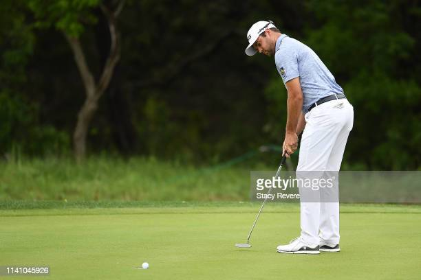 Corey Conners of Canada putts for birdie on the first hole during the final round of the 2019 Valero Texas Open at TPC San Antonio Oaks Course on...