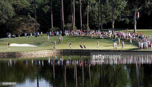 Corey Conners of Canada putts on the fourth hole during the semifinal match of the US Amateur Championship on August 16 2014 at the Atlanta Athletic...