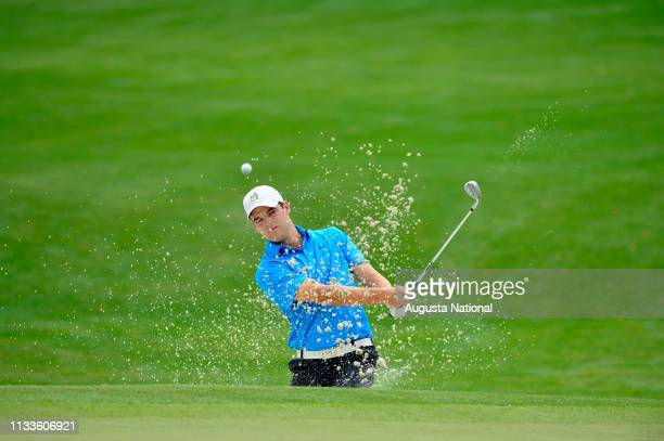 Corey Conners of Canada takes his shot out of the No 16 Hole bunker during Practice Round 1 for the Masters at Augusta National on Monday April 6 2015
