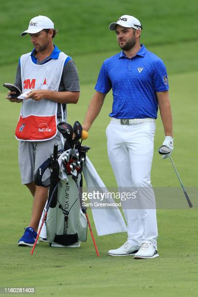 Corey Conners of Canada talks with his caddie on the 12th hole during the second round of the 3M Open at TPC Twin Cities on July 05 2019 in Blaine...
