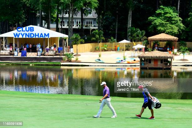 Corey Conners of Canada walks the 15th hole during the first round of the Wyndham Championship at Sedgefield Country Club on August 01 2019 in...