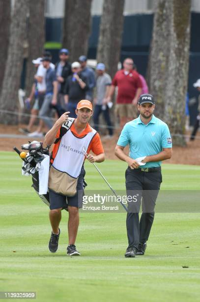 Corey Conners of Canada walks with his caddie on the fifteenth fairway during the third round of THE PLAYERS Championship on THE PLAYERS Stadium...