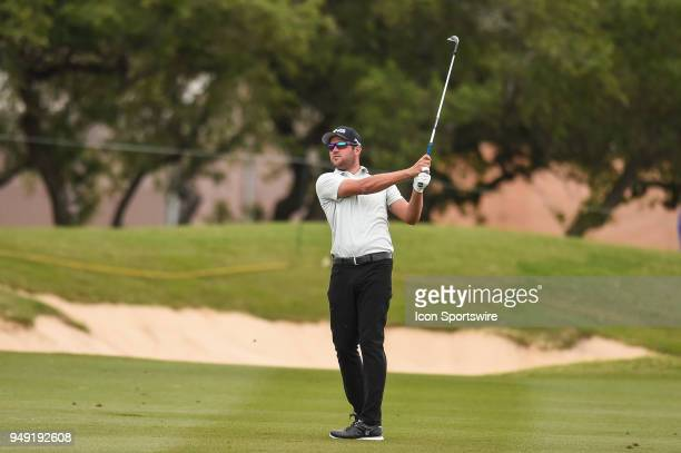 Corey Conners watches his approach shot during the second round of the Valero Texas Open at the TPC San Antonio Oaks Course in San Antonio TX on...