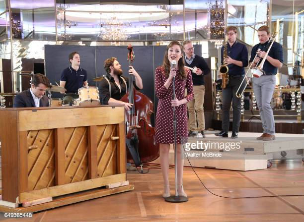 Corey Cott and Laura Osnes with cast perform during the 'Bandstand' Broadway cast press presentation at the Rainbow Room on March 7 2017 in New York...