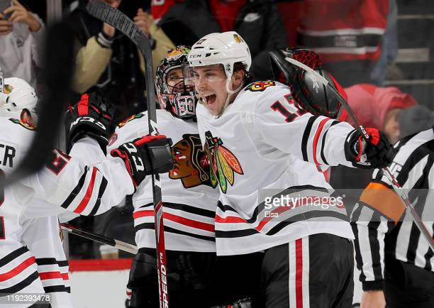 Corey Crawford and Dylan Strome of the Chicago Blackhawks celebrate the win over the New Jersey Devils at Prudential Center on December 06 2019 in...