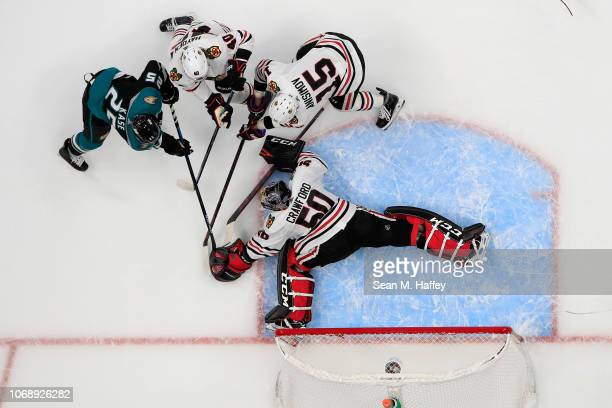 Corey Crawford, Artem Anisimov and John Hayden of the Chicago Blackhawks defend against a shot on goal by Ondrej Kase of the Anaheim Ducks during the...