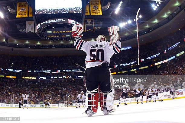 Corey Crawford celebrates after defeating the Boston Bruins in Game Six of the 2013 NHL Stanley Cup Final at TD Garden on June 24 2013 in Boston...