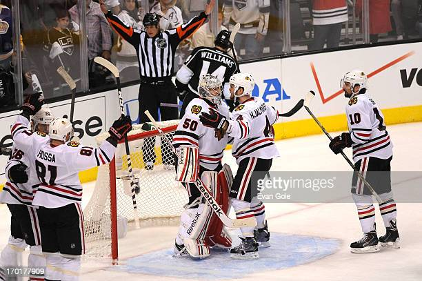 Corey Crawford Niklas Hjalmarsson and Patrick Sharp of the Chicago Blackhawks celebrate against the Los Angeles Kings in Game Four of the Western...