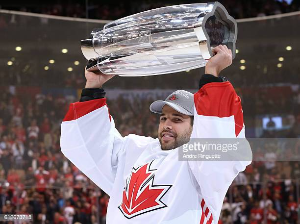 Corey Crawford of Team Canada hoists the World Cup of Hockey trophy during Game Two of the World Cup of Hockey final series at the Air Canada Centre...