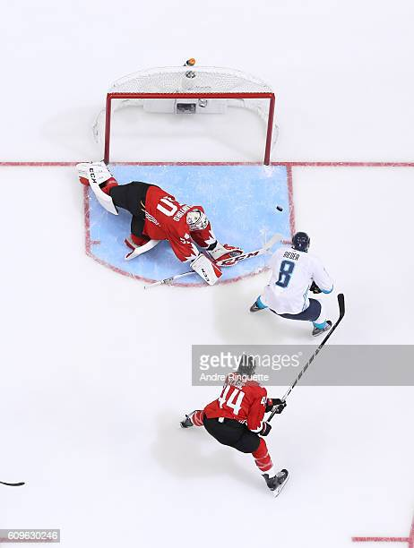 Corey Crawford of Team Canada makes a save against Tobias Rieder of Team Europe during the World Cup of Hockey game at Air Canada Centre on September...