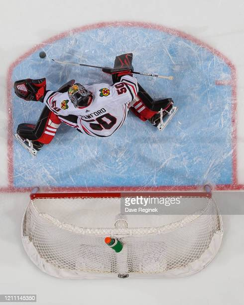 Corey Crawford of the Chicago Blackhawks against the makes a save against the Detroit Red Wings during an NHL game at Little Caesars Arena on March 6...