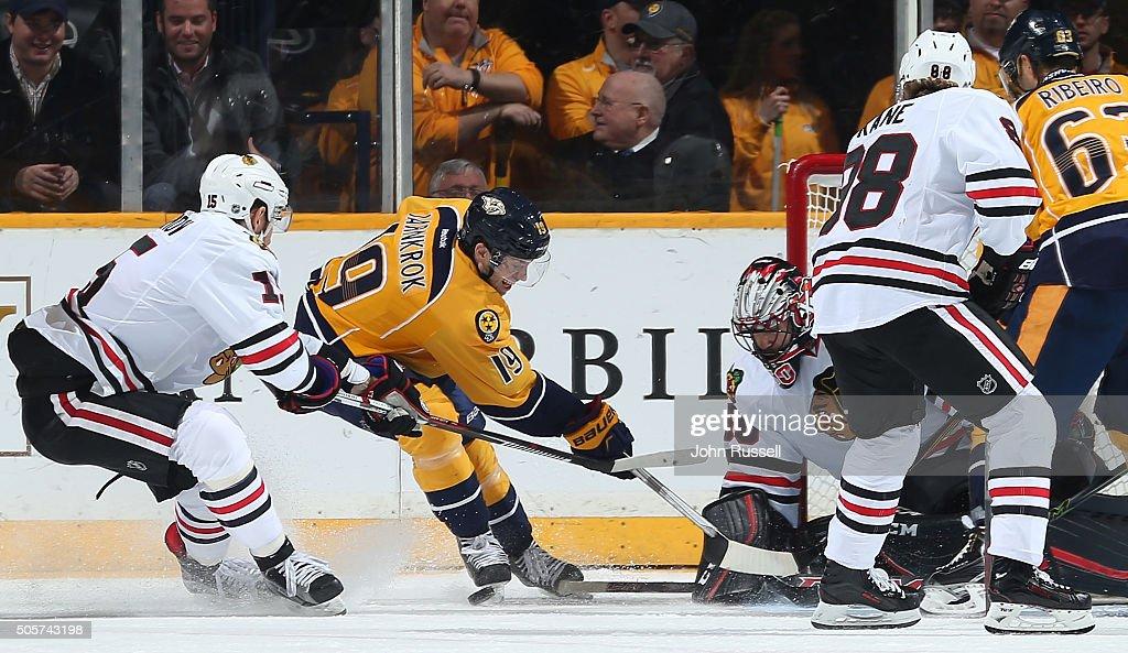 Corey Crawford #50 of the Chicago Blackhawks blocks the shot of Calle Jarnkrok #19 of the Nashville Predators during an NHL game at Bridgestone Arena on January 19, 2016 in Nashville, Tennessee.