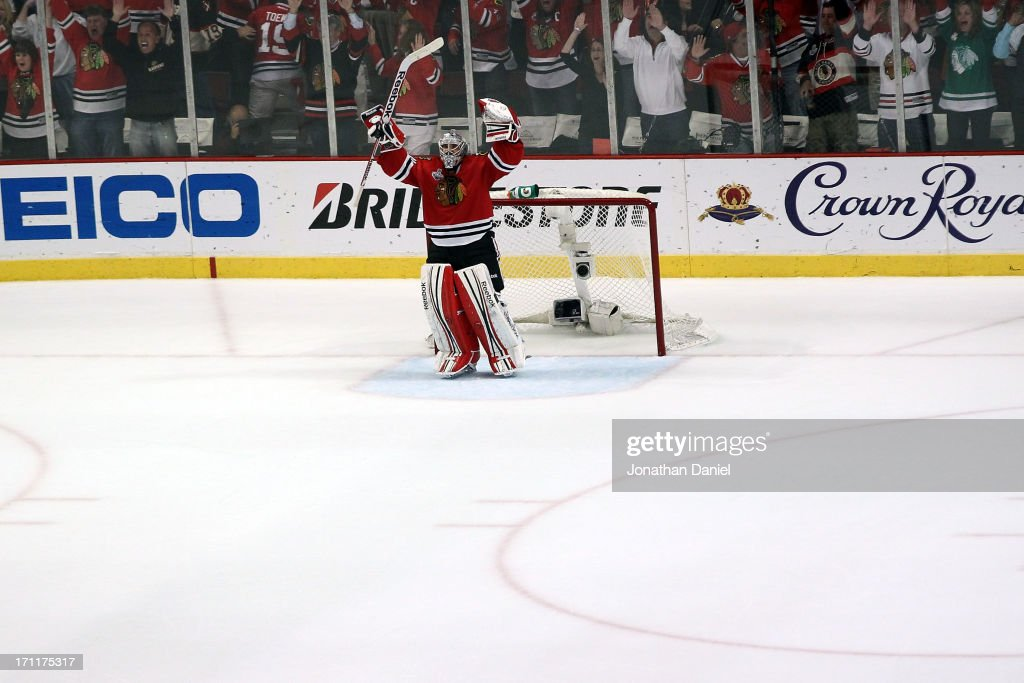 Corey Crawford #50 of the Chicago Blackhawks celebrates an empty net goal scored by Dave Bolland #36 late in the third period against the Boston Bruins in Game Five of the 2013 NHL Stanley Cup Final at United Center on June 22, 2013 in Chicago, Illinois.