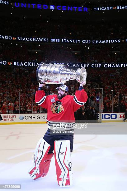 Corey Crawford of the Chicago Blackhawks celebrates by hoisting the Stanley Cup after defeating the Tampa Bay Lightning by a score of 20 in Game Six...
