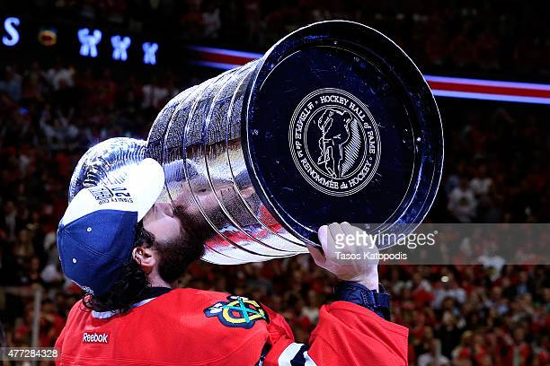 Corey Crawford of the Chicago Blackhawks celebrates by kissing the Stanley Cup after defeating the Tampa Bay Lightning by a score of 20 in Game Six...