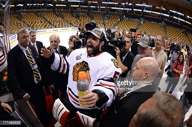 Corey Crawford of the Chicago Blackhawks celebrates following their 32 win against the Boston Bruins in Game Six of the 2013 NHL Stanley Cup Final at...