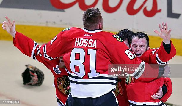 Corey Crawford of the Chicago Blackhawks celebrates with teammates Marian Hossa Andrew Shaw and Jonathan Toews after defeating the Tampa Bay...