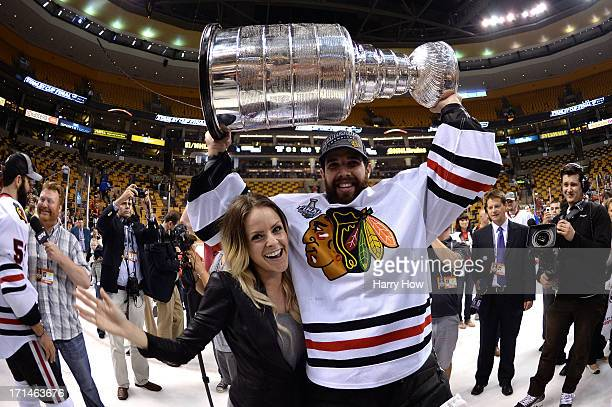 Corey Crawford of the Chicago Blackhawks celebrates with the Stanley Cup and his girlfriend Sylvie Cormier in Game Six of the 2013 NHL Stanley Cup...