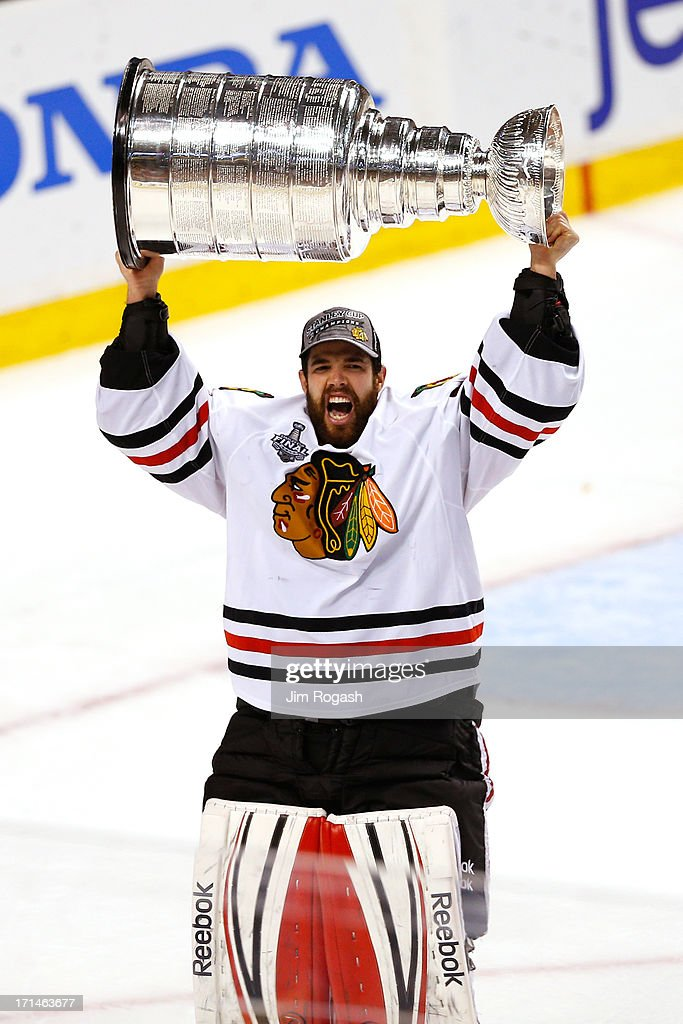 Corey Crawford #50 of the Chicago Blackhawks celebrates with the Stanley Cup after Game Six of the 2013 NHL Stanley Cup Final at TD Garden on June 24, 2013 in Boston, Massachusetts. The Chicago Blackhawks defeated the Boston Bruins 3-2 to win the Stanley Cup Finals.