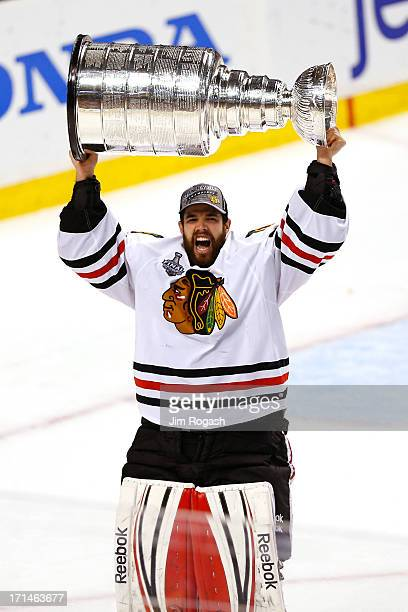 Corey Crawford of the Chicago Blackhawks celebrates with the Stanley Cup after Game Six of the 2013 NHL Stanley Cup Final at TD Garden on June 24...