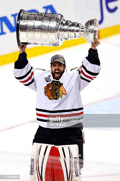 Corey Crawford of the Chicago Blackhawks celebrates with the Stanley Cup after winning in Game Six of the 2013 NHL Stanley Cup Final at TD Garden on...