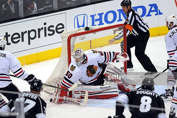 Corey Crawford of the Chicago Blackhawks defends the goal against the Los Angeles Kings in Game Four of the Western Conference Final during the 2013...
