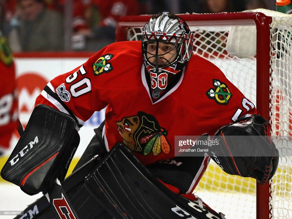 Corey Crawford #50 of the Chicago Blackhawks follows the action against the Vancouver Canucks at the United Center on March 21, 2017 in Chicago, Illinois. The Canucks defeated the Blackhawks 5-4 in overtime.