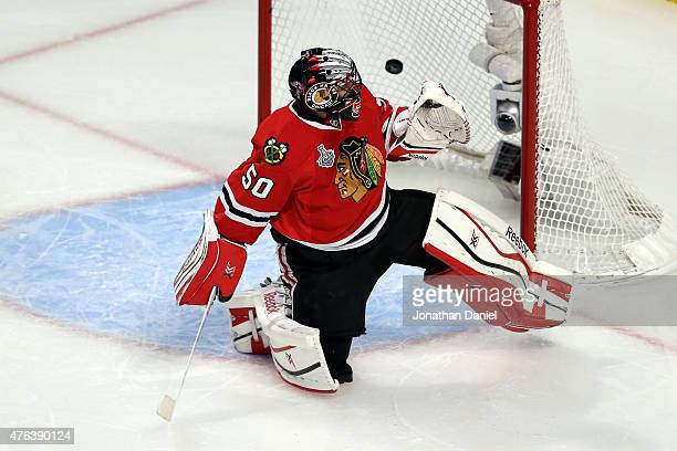 Corey Crawford of the Chicago Blackhawks gives up a goal to Ryan Callahan of the Tampa Bay Lightning during the first period in Game Three of the...