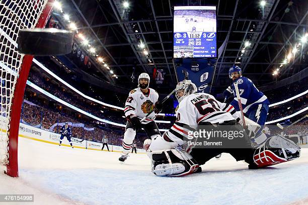 Corey Crawford of the Chicago Blackhawks gives up a third period goal to Jason Garrison of the Tampa Bay Lightning during Game Two of the 2015 NHL...