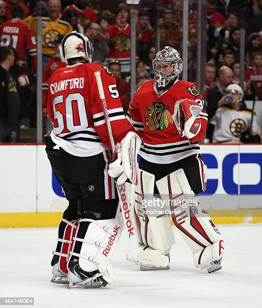 Corey Crawford of the Chicago Blackhawks is replaced in the second period by Antti Raanta against the Boston Bruins at the United Center on February...
