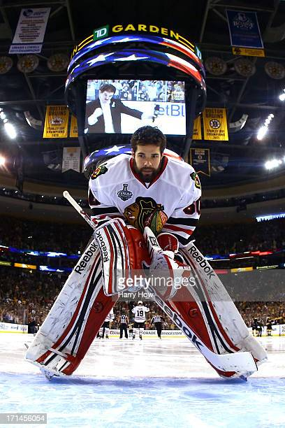 Corey Crawford of the Chicago Blackhawks leans over on the ice during the national anthem prior to Game Six of the 2013 NHL Stanley Cup Final against...