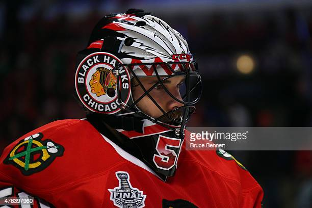 Corey Crawford of the Chicago Blackhawks looks on during a break in play against the Tampa Bay Lightning during Game Three of the 2015 NHL Stanley...