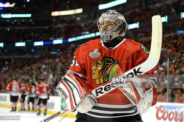 Corey Crawford of the Chicago Blackhawks looks on prior to Game Five of the 2013 NHL Stanley Cup Final against the Boston Bruins at United Center on...