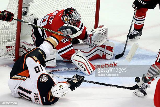 Corey Crawford of the Chicago Blackhawks makes a save against Corey Perry of the Anaheim Ducks in Game Four of the Western Conference Finals during...