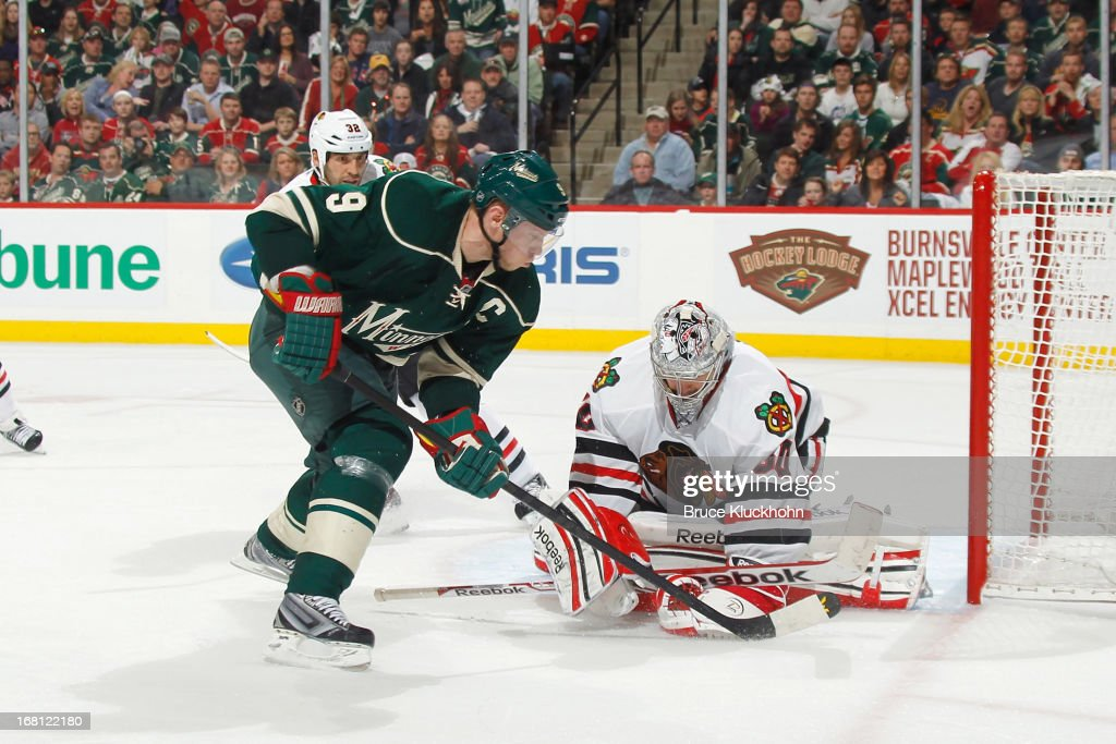 Corey Crawford #50 of the Chicago Blackhawks makes a save against Mikko Koivu #9 of the Minnesota Wild during Game Three of the Western Conference Quarterfinals during the 2013 NHL Stanley Cup Playoffs on May 5, 2013 at the Xcel Energy Center in St. Paul, Minnesota.